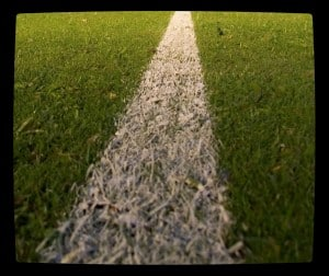 White chalk line marking yardline in grass