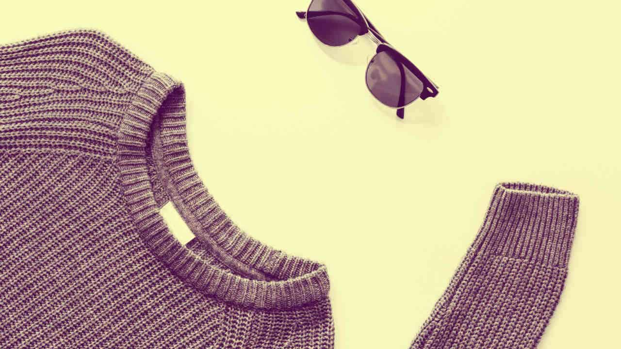 Sunglasses above sweater with no face